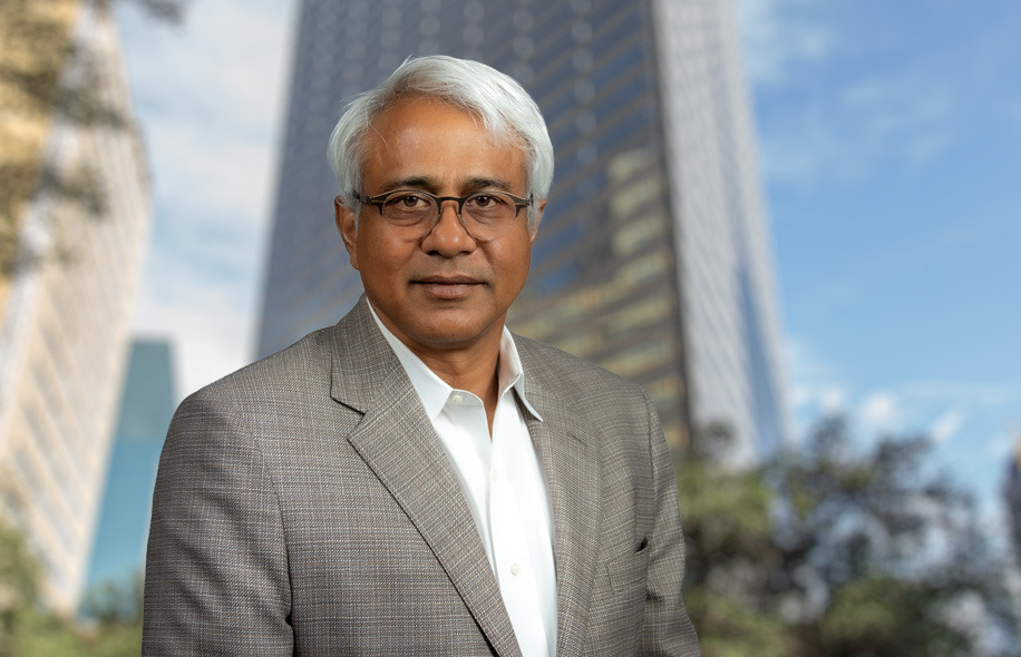 Mahesh Aditya, CEO, staanding in front of Santander Tower in Deallas, TX